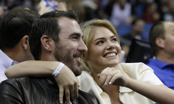 Detroit Tigers pitcher Justin Verlander, left, and model Kate Upton were both hit in the nude photos hack; more males might become victims soon. (AP Photo/John Raoux)