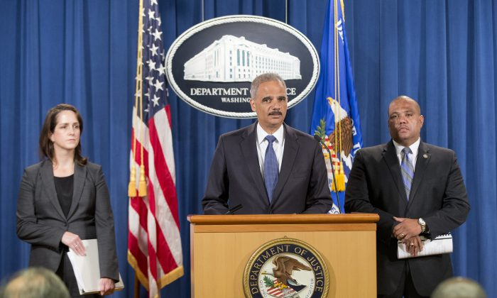 U.S. Attorney General Eric Holder announces a Justice Department 'patterns and practice' investigation of the Ferguson, Mo., police department during a news conference in Washington on Sept. 4, 2014. (Chip Somodevilla/Getty Images)