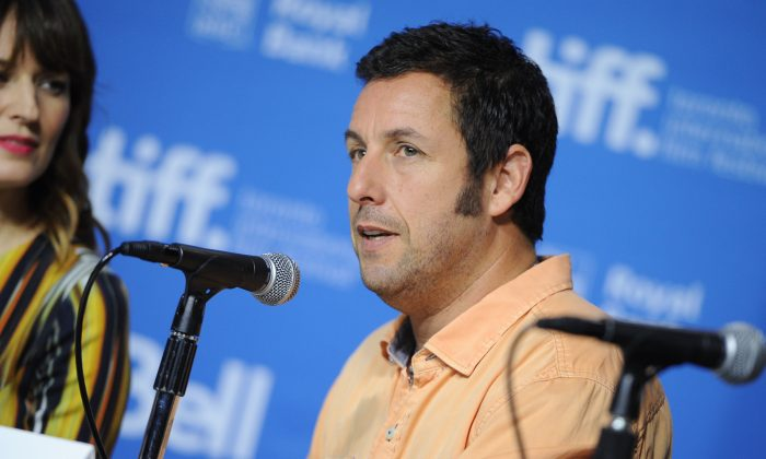 """Actor Adam Sandler participates in the """"Men, Women & Children"""" press conference during the Toronto International Film Festival on Saturday, Sept. 6, 2014, in Toronto. (Photo by Evan Agostini/Invision/AP)"""