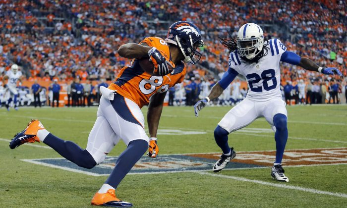 Denver Broncos wide receiver Demaryius Thomas (88) looks to run as Indianapolis Colts cornerback Greg Toler (28) defends during the first half of an NFL football game, Sunday, Sept. 7, 2014, in Denver. (AP Photo/Jack Dempsey)