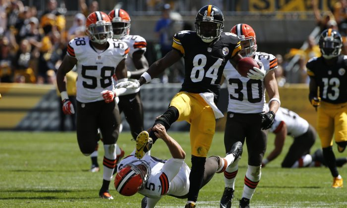 Pittsburgh Steelers Antonio Brown (84) kicks Cleveland Browns punter Spencer Lanning (5) as he jumps while returning a punt in the second quarter of the NFL football game in Pittsburgh on Sunday, Sept. 7, 2014 (AP Photo/Gene J. Puskar)