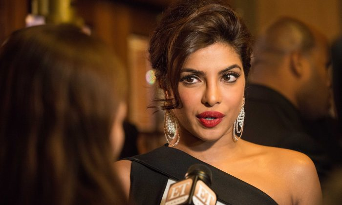 "Actress Priyanka Chopra walks the red carpet at the premier of her latest film ""Mary Kom"" at Elgin Theatre in Toronto Sept 4, 2014. (Matthew Little/Epoch Times)"