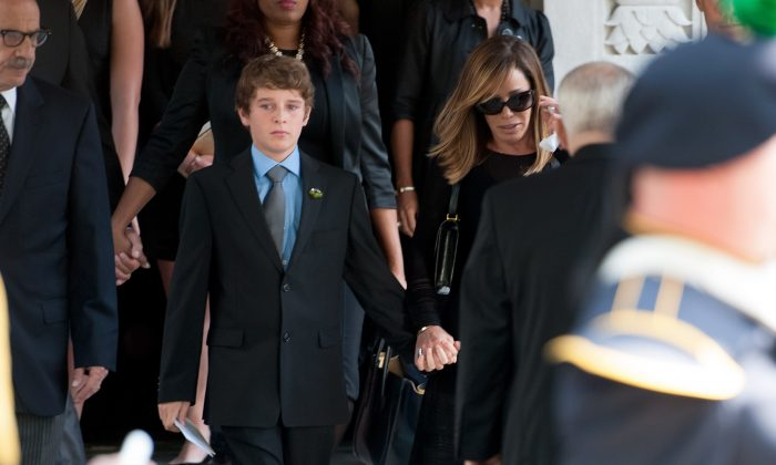 Melissa Rivers (center R) and son Cooper Endicott (center L) attend the Joan Rivers memorial service at Temple Emanu-El on September 7, 2014 in New York City. Rivers passed away on September 4, 2014 after suffering respiratory and cardiac arrest during vocal cord surgery on August 28, 2014. (D Dipasupil/Getty Images)