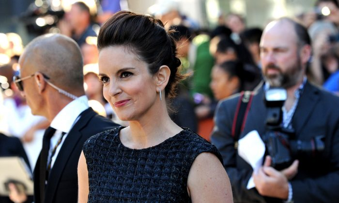 """Tina Fey arrives at the premiere of """"This is Where I Leave You"""" on day 4 of the Toronto International Film Festival at Roy Thomson Hall on Sunday, Sept. 7, 2014, in Toronto. (Photo by Evan Agostini/Invision/AP)"""