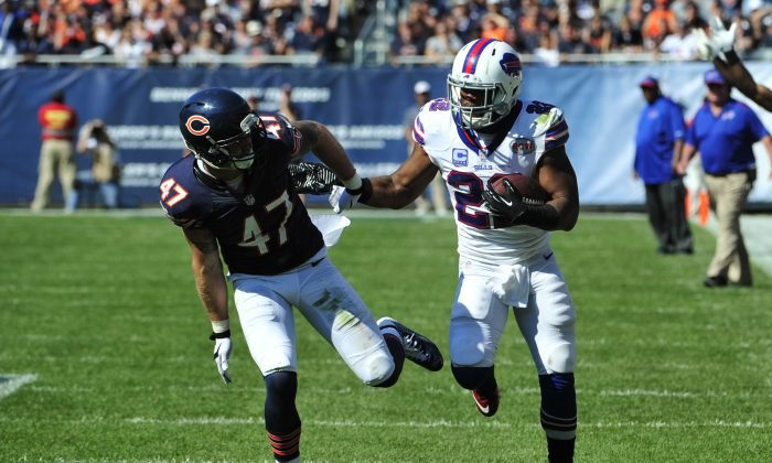 Fred Jackson (R) of the Buffalo Bills prepares to give Chris Conte of the Chicago Bears a stiff-arm in overtime at Soldier Field in Chicago on Sept. 7, 2014. (David Banks/Getty Images)