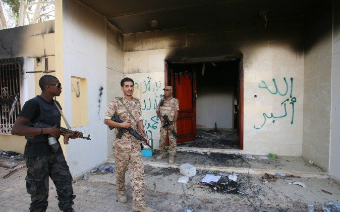 In this Sept. 14, 2012, photo Libyan military guards check one of the US consulate's burned buildings in Benghazi, after a deadly attack on Sept. 11, 2012, that killed four Americans.  (AP Photo/Mohammad Hannon)