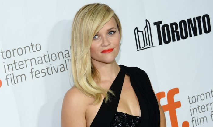 """Actress Reese Witherspoon attends the """"Wild"""" premiere at Roy Thomson Hall during the Toronto International Film Festival on Monday, Sept. 8, 2014, in Toronto. (Photo by Evan Agostini/Invision/AP)"""