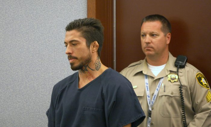 Jonathan Paul Koppenhaver, a mixed martial arts fighter known as War Machine, appears in court Wednesday, Sept. 3, 2014, in Las Vegas.  (AP Photo/Las Vegas Review-Journal, Michael Quine)