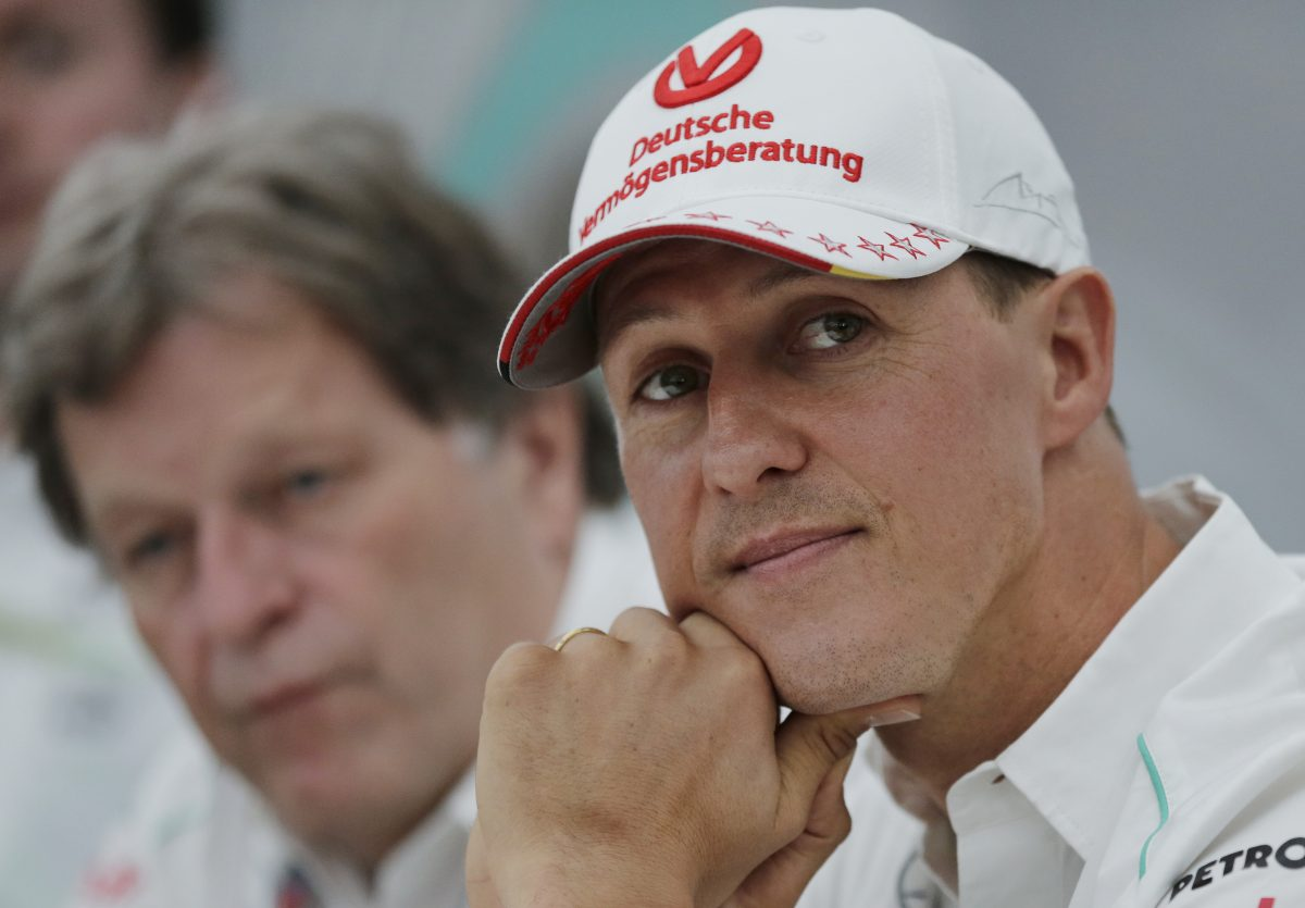 Former Mercedes F1 driver Michael Schumacher of Germany pauses during a news conference to announce his retirement from Formula One at the end of 2012 in Suzuka Japan Oct. 4 2012