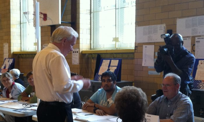 Incumbent state Senator Tony Avella casts his vote at a polling station in north Flushing on Tuesday, Sept. 9, 2014. He faces off with challenger and former city comptroller John Liu in a tight race. (Annie Wu/Epoch Times)