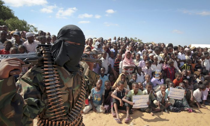 In this Feb. 13, 2012, photo an armed member of the militant group al-Shabab attends a rally in support of the merger of the Somali militant group al-Shabab with al-Qaeda, on the outskirts of Mogadishu, Somalia. US military forces targeted the Islamic extremist al-Shabab network in an operation on Sept. 1, 2014, in Somalia, the Pentagon said. (AP Photo)