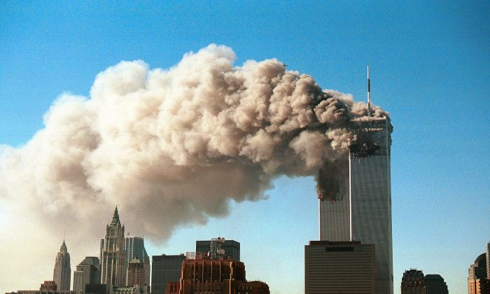 9/11: Smoke pours from the twin towers of the World Trade Center after they were hit by two hijacked airliners in a terrorist attack in N.Y., on Sept. 11, 2001. (Robert Giroux/Getty Images)
