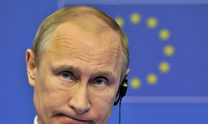 Russian president Vladimir Putin during a press conference in Brussels on January 28, 2014. (Georges Gobet/AFP/Getty Images)