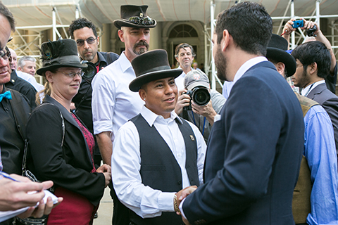 Council member Rafael Espinal (R) shakes hands with Angel Herdez who has been a horse-drawn carriage driver for eight years, on the steps of City Hall in Manhattan on Sept. 10, 2014. (Benjamin Chasteen/Epoch Times)