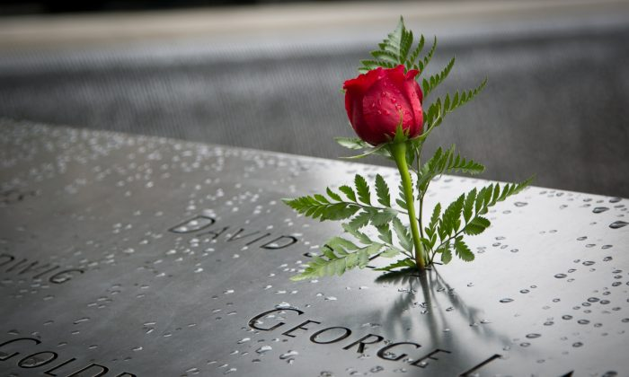 A rose is placed on the name David S. Lee at the 9/11 Memorial on Sept. 9, 2014, who died at the site of the World Trade Center in New York City. (Samira Bouaou/Epoch Times)
