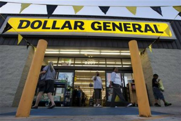 Customers exit a Dollar General store, in San Antonio. Dollar General is going hostile with its $9.1 billion bid for Family Dollar after repeated rejections of previous offers by its rival. (AP Photo/Eric Gay)