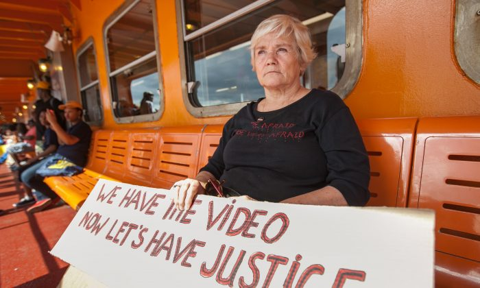 Karen Hofmann, 71, on her way to a rally against police brutality on Staten Island, Aug. 23, 2014. The rally was prompted by the death of Eric Garner during a police arrest where he was put in a chokehold by police. The act was captured on video by a passerby. Its public release prompted a storm of complaints, as well as reforms at the NYPD and the independent Civilian Complaint Review Board. (Petr Svab/Epoch Times)