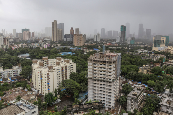Residential and commercial buildings stand in the Parel area of Mumbai, India, on Friday, Aug. 8, 2014. (Dhiraj Singh/Bloomberg /Getty Images)