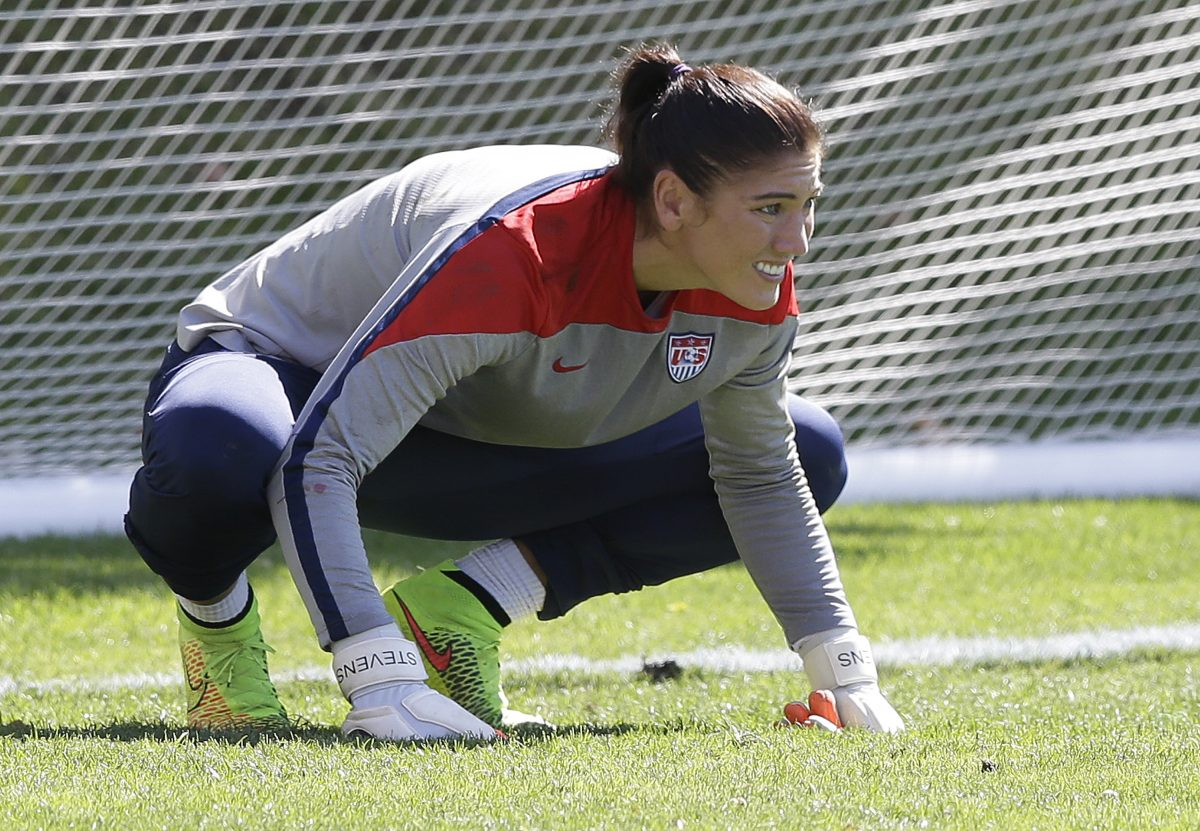 Hope Solo, Lake Bell: Graphic Photos of Soccer Player and
