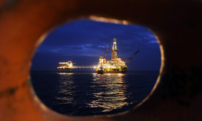 Russian LUKOIL ice-resistant fixed platform LSP-1 built to drill and operate wells and collect and pre-treat reservoir content at Korchagin's oil field in the Russian sector of the Caspian Sea in this file photo. A joint venture with Russian oil company OAO Rosneft has ended with new sanctions against Russia. (Mikhail Mordasov/AFP/Getty Images)