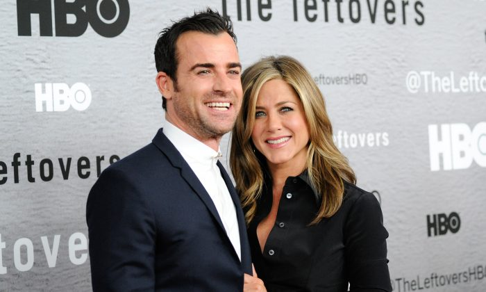 """Actors Justin Theroux and Jennifer Aniston attend HBO's """"The Leftovers"""" season premiere at the NYU Skirball Center on Monday, June 23, 2014 in New York. Theroux breaks his silence on the Angelina Jolie and Brad Pitt divorce.(Photo by Evan Agostini/Invision/AP)"""