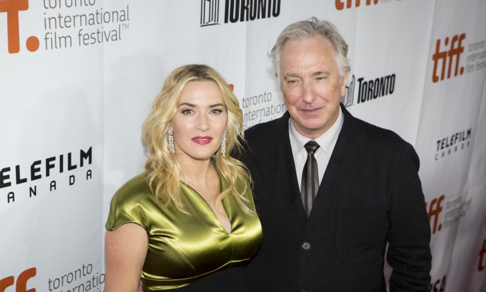 "Kate Winslet and Alan Rickman attend the red carpet premiere of ""A Little Chaos"", Sept. 13, 2014, in which she plays a revolutionary garden designer in the court of Louis XIV, who is played by Rickman. (Evan Ning/Epoch Times)"