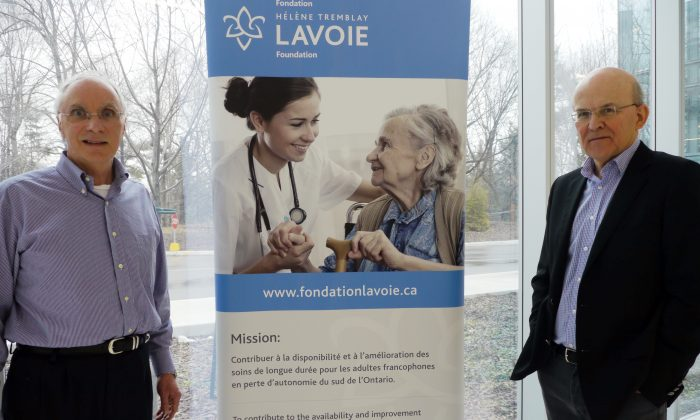 Jean Roy(L), Chairman of the Board of Directors of the Hélène Tremblay-Lavoie foundation and Guy Proulx, neuropsychologist and professor in the Department of Psychology at Glendon College, pose in Toronto on April 13, 2013. (Thibault Jourdan/AFP/Getty Images)