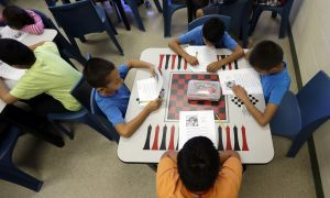 In Midst of Deportation Trials, Migrant Children Offered Schooling and Healthcare