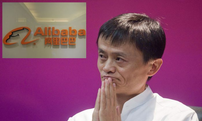 Jack Ma poses in front of the logo of Alibaba.com near its office in Hong Kong on Feb. 22, 2012. (Aaron Tam/AFP/Getty Images)