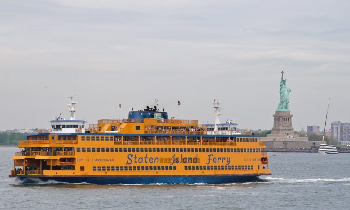 The Staten Island ferry transports commuters with Empire State Building in the background. (InSapphoWeTrust, CC BY-SA)