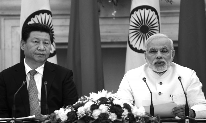 Chinese leader Xi Jinping (L) speaks at joint press conference with Indian Prime Minister Narendra Modi in New Delhi on Sept. 18. India's prime minister expressed concern about incidents on the two countries' disputed border, as a standoff between troops at the frontier overshadowed key talks. (Raveendran/AFP/Getty Images)