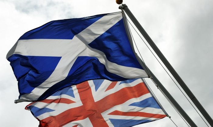 The Saltire, the flag of Scotland, flies above the Union flag in this file photo.  (Andy Buchanan/AFP/Getty Images)