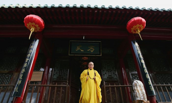 Shi Yongxin, abbot of the Shaolin Temple, walks out of the monastery premises in in Dengfeng City, Henan Province, China, on April 7, 2005. (Cancan Chu/Getty Images)