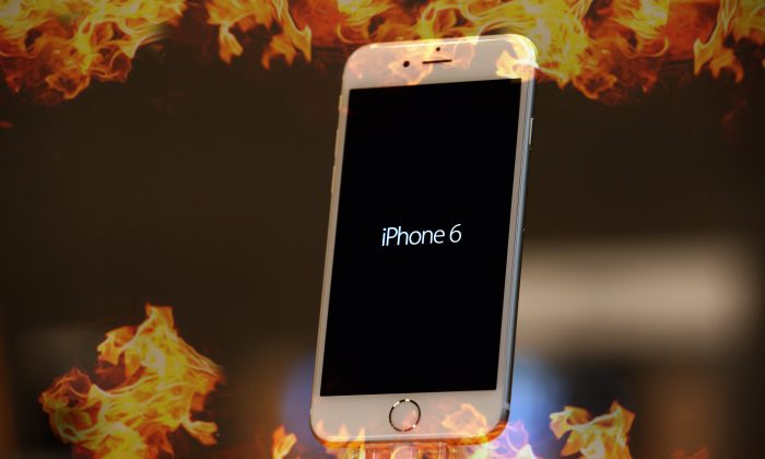 An Apple iPhone 6 stands on display at the Apple Store on the first day of sales of the new phone in Germany on Sep. 19, 2014 in Berlin. (Background: Sean Gallup/Getty Images)
