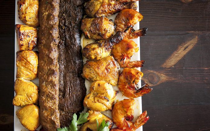An assortment of kebabs. The jujeh, or Cornish hen, is especially sought out at Parmys. Prices for kebabs range from $14.50 (chicken, koobideh, or vegetarian) to $59 for a combination. (Samira Bouaou/Epoch Times)