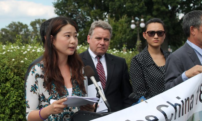 Grace Gege Ge, daughter of human rights lawyer Gao Zhisheng, speaks at a news conference Sep. 17 outside the Capitol Building in Washington, D.C. Next to her is Congressman Chris Smith (R-N.J.). (Tiffany Wu/ Epoch Times)