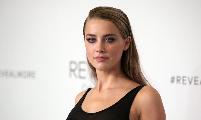 Amber Heard has donated her $7 million dollar divorce settlement from Johnny Depp to charity. (Andy Kropa/Invision/AP)
