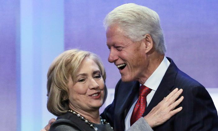 """Former Secretary of State Hillary Rodham Clinton is welcomed to the stage by her husband, former U.S. President Bill Clinton, at the Clinton Global Initiative, Monday, Sept. 22, 2014 in New York. The session is called """"Reimagining Impact."""" (AP Photo/Mark Lennihan)"""