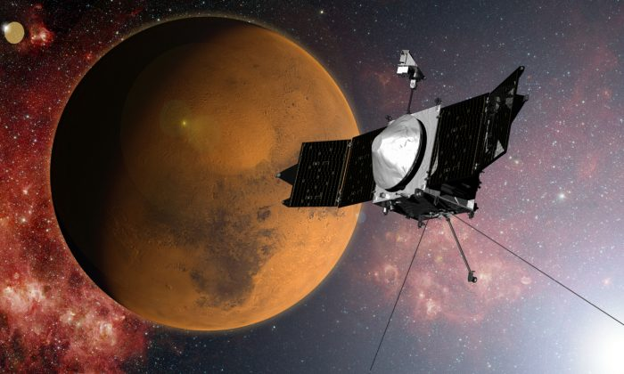 In this artist concept provided by NASA, the MAVEN spacecraft approaches Mars on a mission to study its upper atmosphere. When it arrives on Sunday Sept. 21, 2014, MAVEN's 442 million mile journey from Earth will culminate with a dramatic engine burn, pulling the spacecraft into an elliptical orbit. It's designed to circle the planet, not land. (AP Photo/NASA)