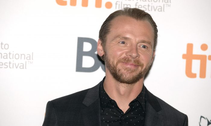 """Simon Pegg arrives at the premiere of """"Kill Me Three Timesl"""" on day 3 of the Toronto International Film Festival at the Scotiabank Cinema 2 on Saturday, Sept. 6, 2014, in Toronto. (Photo by Brian Bettencourt/Invision/AP)"""