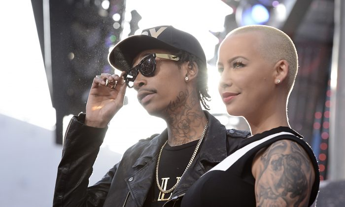 "FILE - In this May 21, 2013 file photo, rapper Wiz Khalifa, left, and Amber Rose arrive at the LA Premiere of the ""Fast & Furious 6"" in Universal City, Calif.  Rose filed for divorce from Khalifa on Tuesday, Sept. 23, 2014, in Los Angeles. The model cited irreconcilable differences as the reason for the couple's breakup after a year of marriage. (Photo by Dan Steinberg/Invision/AP)"