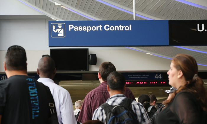 International travelers wait to have their passports checked at O'Hare International Airport in Chicago on Sept. 19, 2014. (Scott Olson/Getty Images)