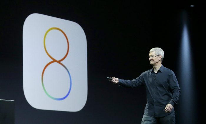 After the release of iOS 8.2 this week, there's still time to downgrade to iOS 8.1.3.  (AP Photo/Jeff Chiu, File)