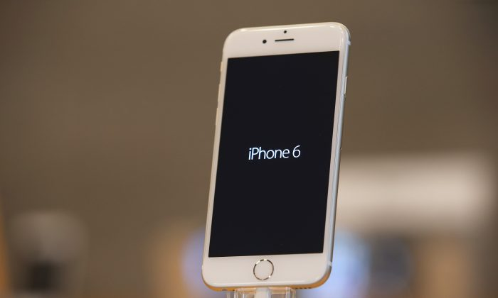 An Apple iPhone 6 stands on display at the Apple Store on the first day of sales of the new phone in Berlin Germany on Sept. 19, 2014. (Sean Gallup/Getty Images)
