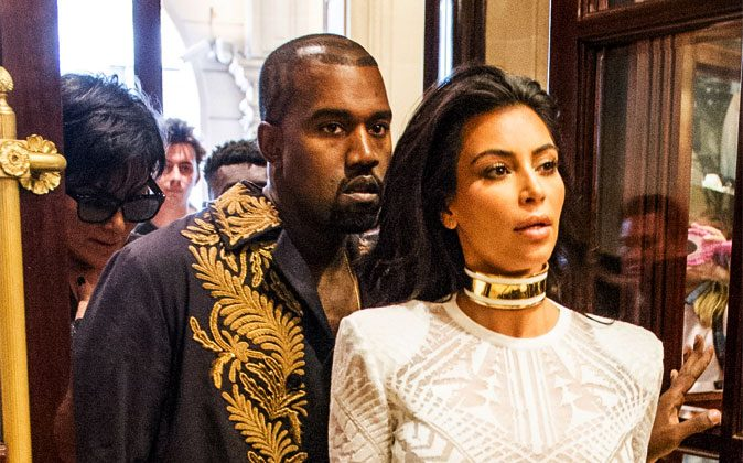 Kim Kardashian and her husband Kanye West arrives at the Balmain Spring/Summer 2015 ready-to-wear fashion collection, in Paris, France, on, Sept. 25, 2014. (AP Photo/Zacharie Scheurer)