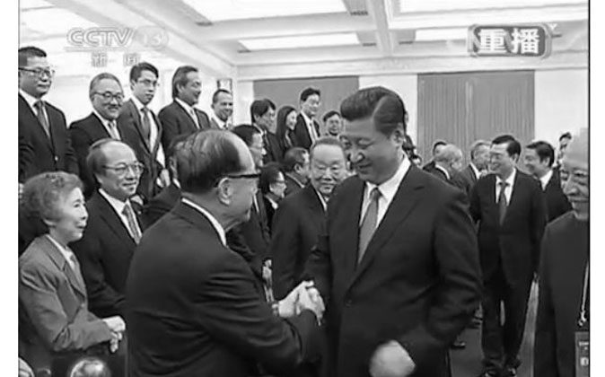 On Sept. 22, Xi Jinping met with a delegation of businessmen from Hong Kong. The occasion was used by Xi to strike a less aggressive tone on the Hong Kong issue than other officials in Beijing have. (Screenshot via CCTV)