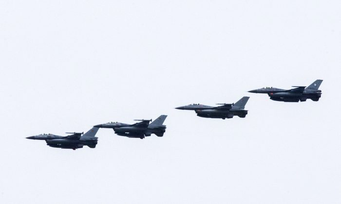 Four Dutch F-16s fly near the Leeuwarden Airbase near Leeuwarden on Sept. 25, 2014. Six Dutch F-16 fighter bombers are to join the US-led air campaign against the Islamic State group in Iraq, Deputy Prime Minister Lodewijk Asscher announced. (Vincent Jannink/AFP/Getty Images)