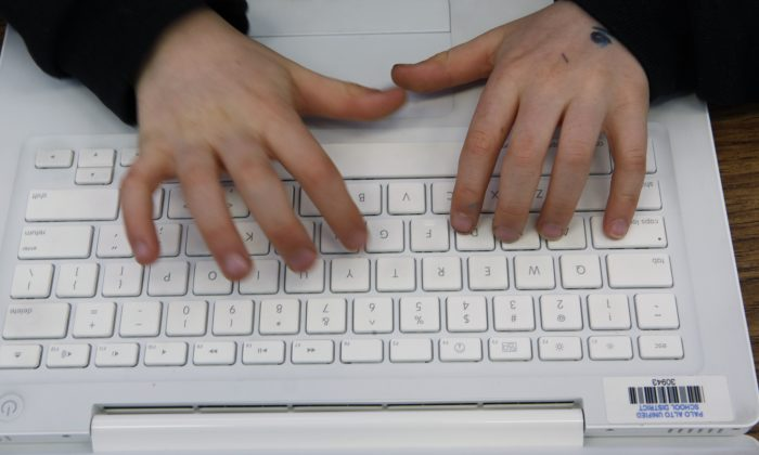 "A person uses an Apple MacBook laptop in his class in Palo Alto, Calif. New warnings are emerging of a security flaw known as the ""Bash"" bug, which cyber experts say may pose a serious threat to computers and other devices using Unix-based operating systems such as Linux and Mac OS X. (AP Photo/Paul Sakuma, File)"