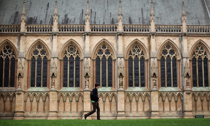 A student walks through St John's College in Cambridge, England, on March 13, 2012. (Dan Kitwood/Getty Images)