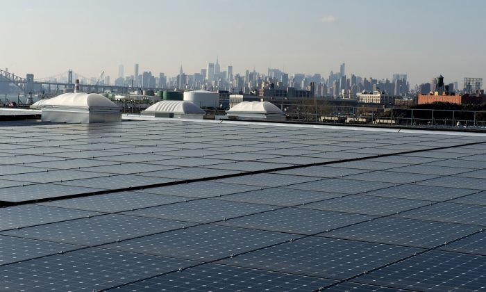 Solar panels on the rooftop in the Bronx, with a view of Manhattan in the distance, on January 17, 2014 in New York. (Don Emmert/AFP/Getty Images)